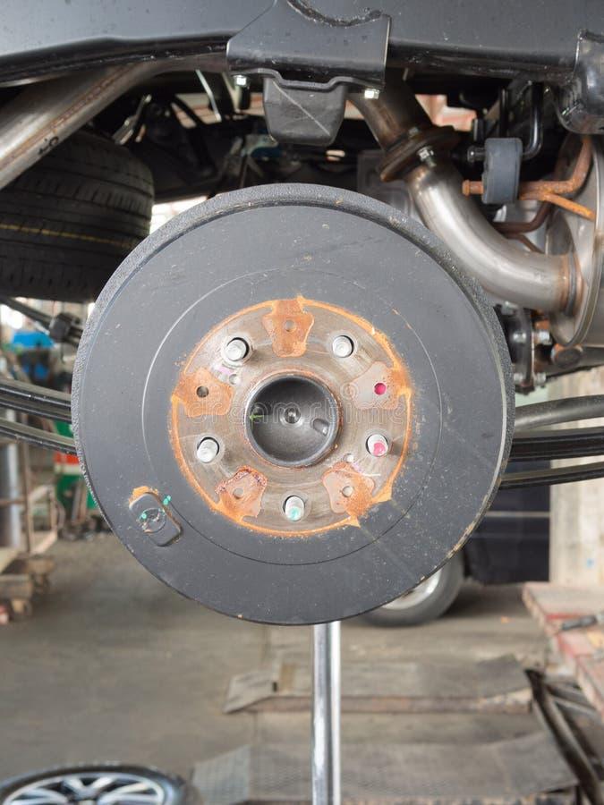 Disc break in maintenance. Wheel and disc break in maintenance process stock photos