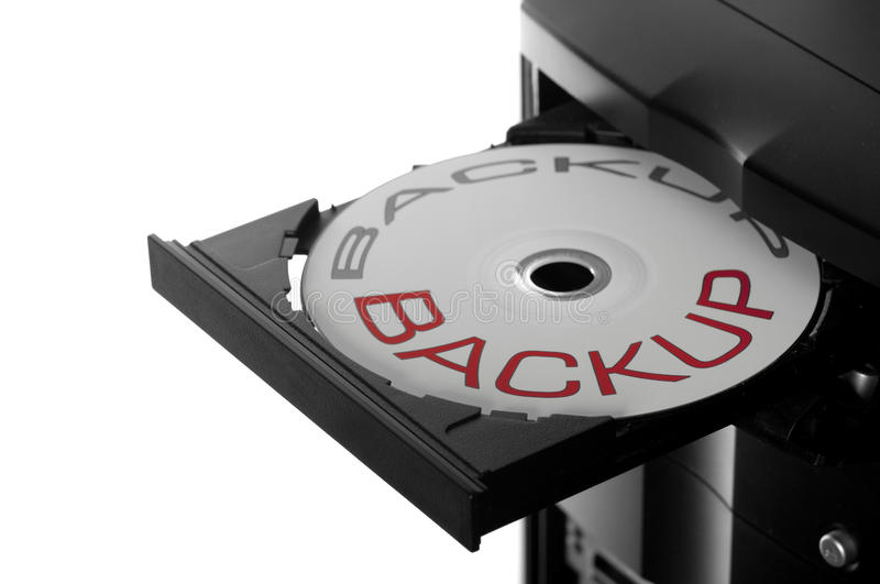 Disc in drive. Dvd or cd disc in open drive for backup isolated on white royalty free stock images