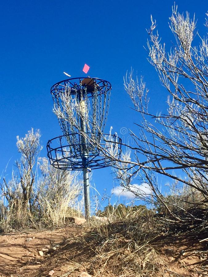 Disc Golf basket on a course in New Mexico royalty free stock photos