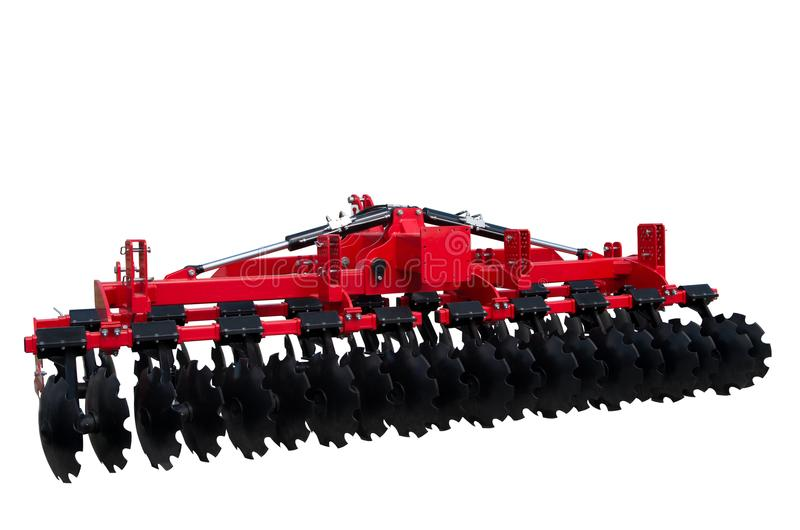 Disc harrow trailer for a farming tractor. Metal discs to break ground. Isolated on white. Tillage equipment. The disk harrow. Agricultural machinery for stock photos