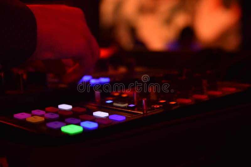 Disc jockey hand with mixer royalty free stock images