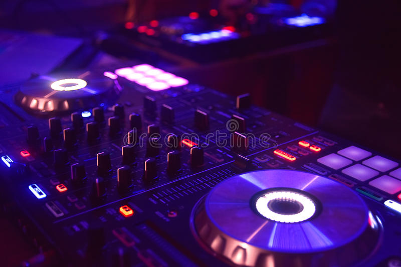 Disc jockey mixing table with lights royalty free stock photo