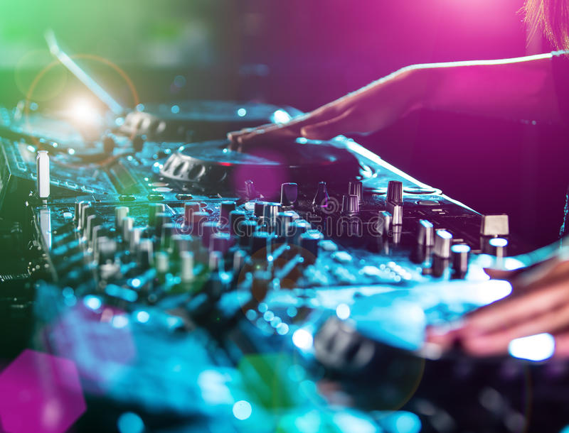 Disc jockey at the turntable. Party concept royalty free stock photography