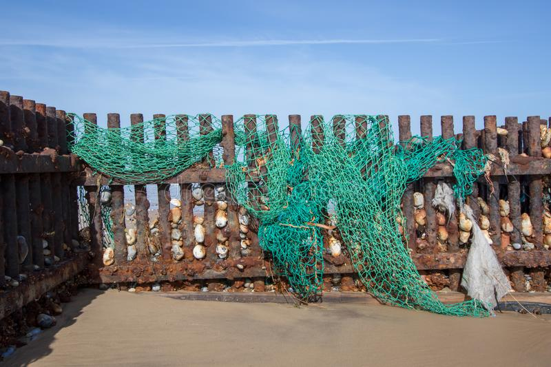 Discarded fishing net. Evironmental sea pollution threat to wild. Discarded nylon plastic fishing net. Evironmental sea pollution threat to wildlife washed up on royalty free stock photo