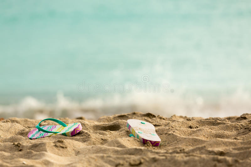 Download Discarded Flipflops On Sandy Beach By Ocean Stock Image - Image: 29450521
