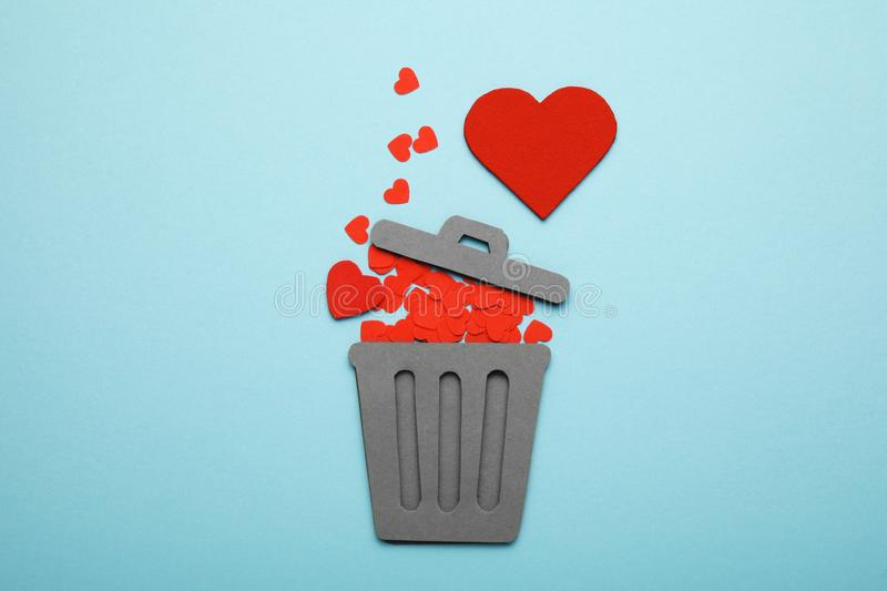 Discarded heart and relationship in couple. Red broken hearts in trash can stock images