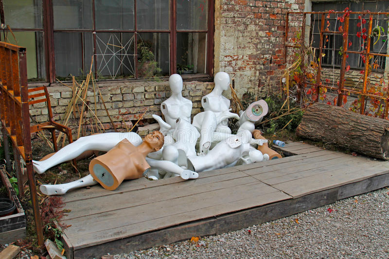 Discarded nude mannequins in junkyard. Group of discarded nude mannequins in junkyard stock images