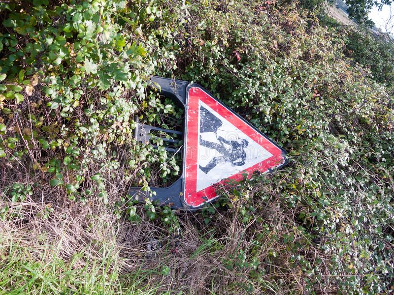 discarded old ruined weathered triangle road sign digging warning stock photos