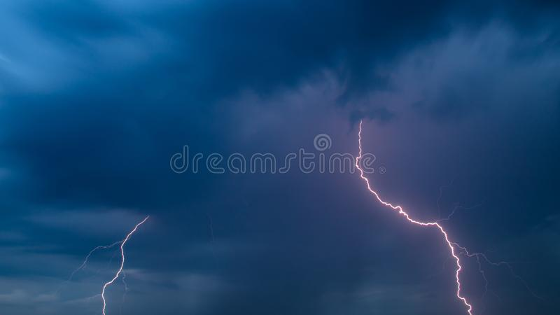 The discharge of lightning in the sky as a background stock image