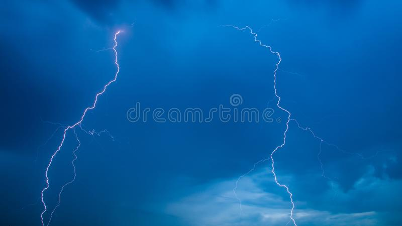 The discharge of lightning in the sky as a background royalty free stock photo