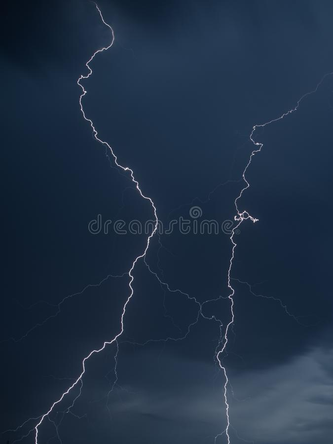 The discharge of lightning in the sky as a background stock photo