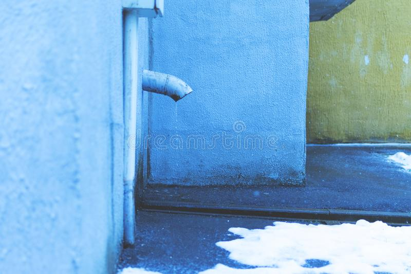 The discharge of water at the entrance. Pipe. Close up. stock photos