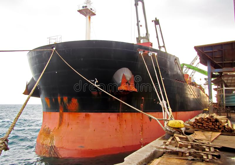 Discharging of cargo scrap metal from cargo ship in the port of Iskenderun, Turkey. A close-up view of cargo residues on the deck. Of the vessel and its royalty free stock images