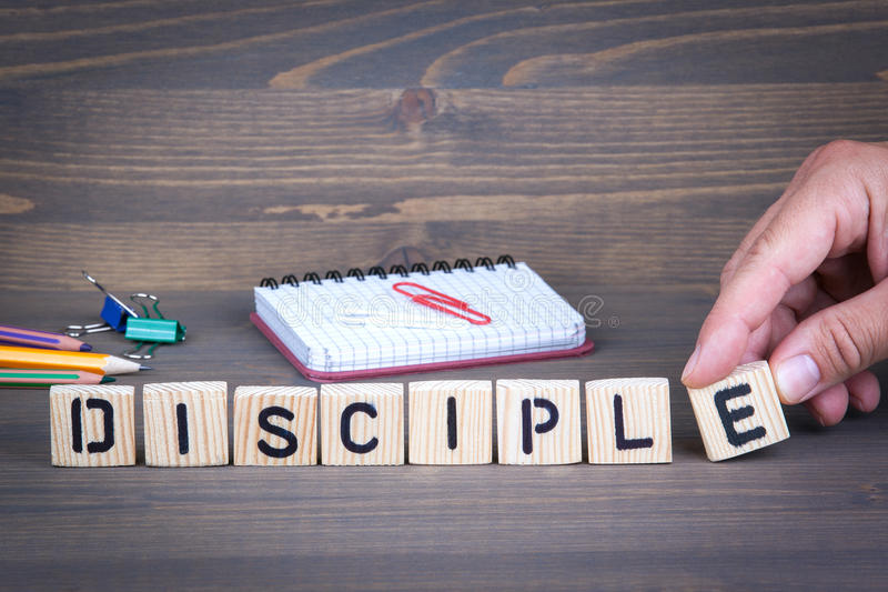 Disciple from wooden letters on wooden background stock photo