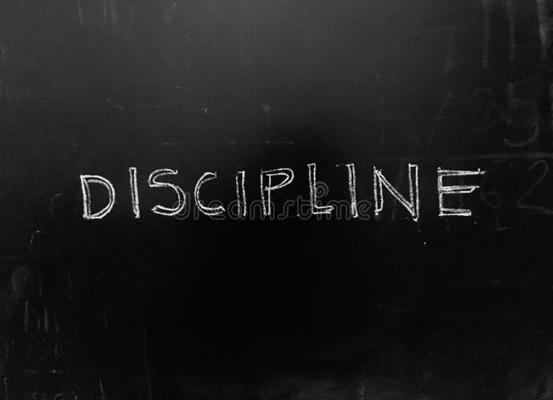 Discipline manuscrite sur Blackboard photo d'actions photo libre de droits