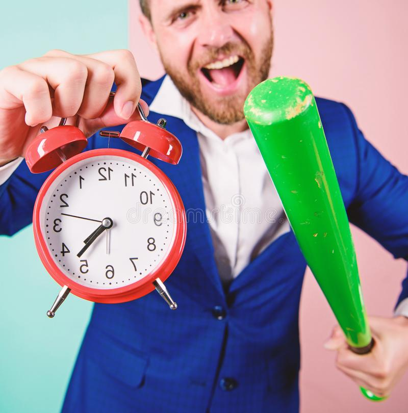 Discipline and sanctions. Boss aggressive face hold alarm clock and baseball bat. Man suit hold clock in hand and royalty free stock photos