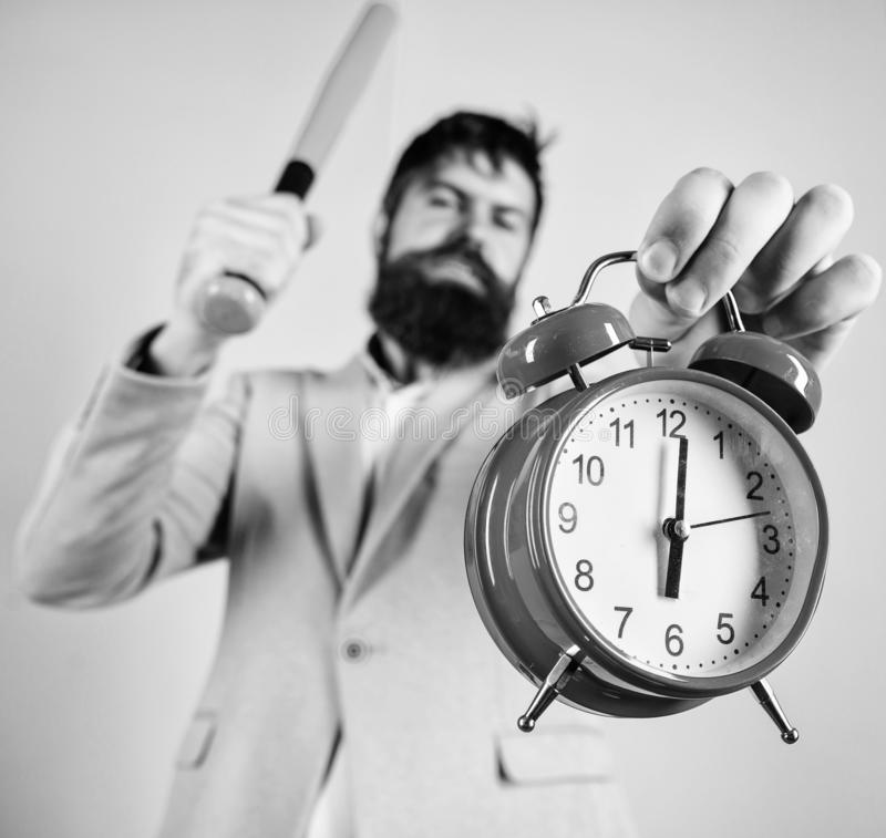 Discipline and sanctions. Boss aggressive face hold alarm clock. Destroy or turn off. Man suit hold clock and baseball stock photos