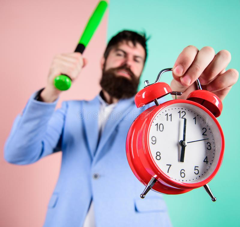 Discipline and sanctions. Boss aggressive face hold alarm clock. Destroy or turn off. Man suit hold clock and baseball. Bat in hands. Business discipline royalty free stock images