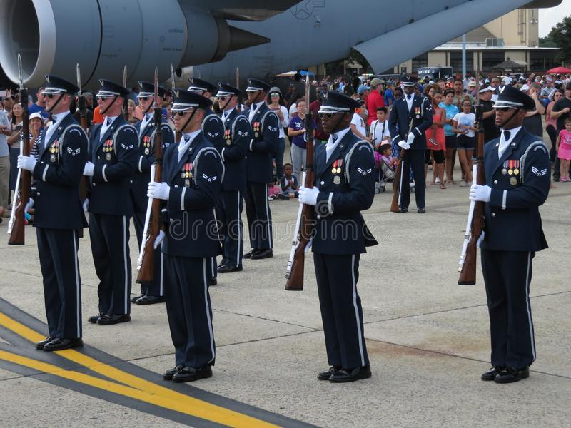 Disciplined Drill Team. Photo of military drill team holding rifles with bayonets at andrews air force base in maryland during an air show on 9/16/17. These royalty free stock image