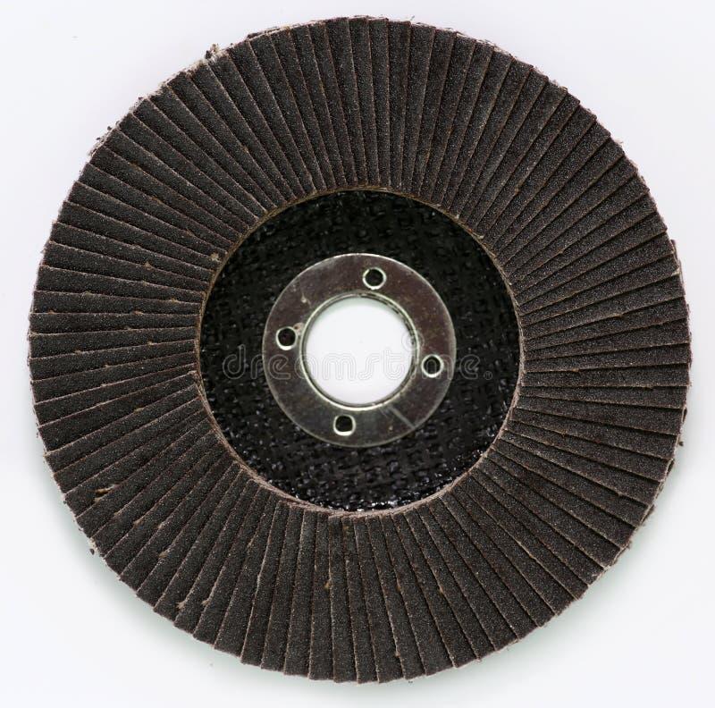 Disco abrasivo per la smerigliatrice su fondo bianco fotografie stock