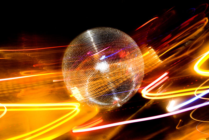 Disco ball. With colorful spotlights surrounding the ball royalty free stock images