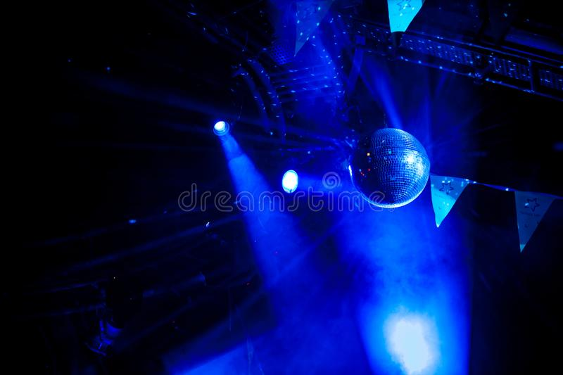 Disco ball with bright blue rays. Night party background photo stock image