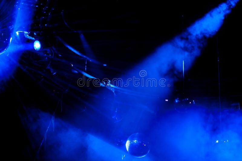 Disco ball with bright blue rays. Night party background photo royalty free stock photography