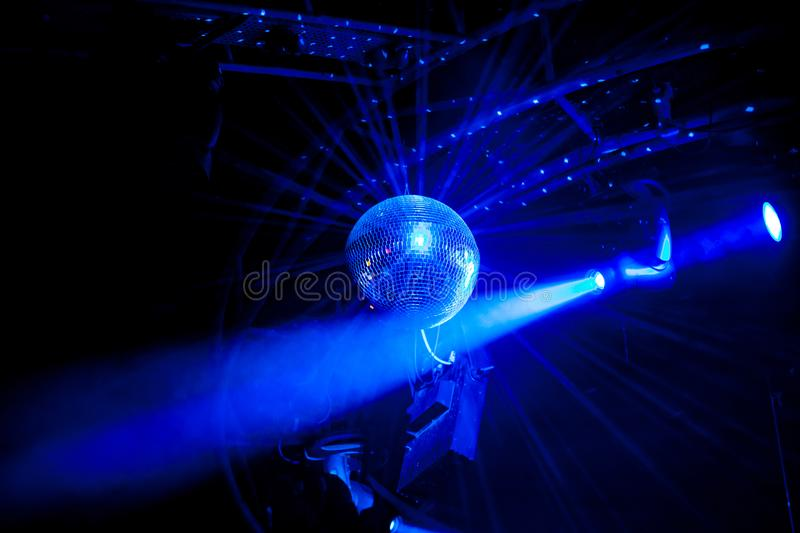 Disco ball with bright blue rays. Night party background photo royalty free stock photo