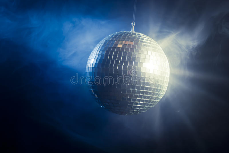 Disco ball with light rays stock image