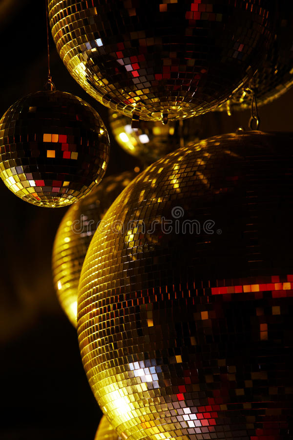Disco balls. Vertical image of disco balls sparkling in darkness stock photos