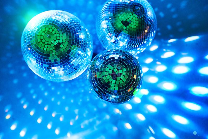 Disco balls with colorful bright rays , night party background photo stock photo