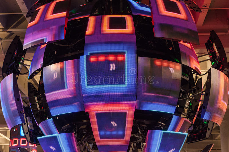 Disco coloured ball with red pink violet colours. Disco coloured ball with red pink violet colors and details of electronic pieces and LED modules royalty free stock photos
