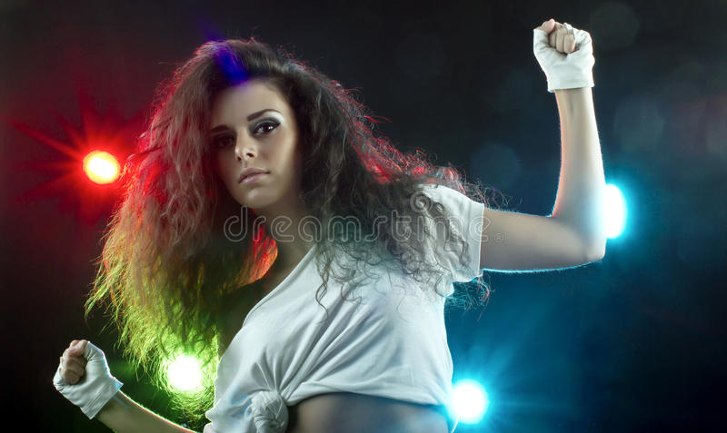 Beautiful Woman Dancing in Disco Spotlights royalty free stock photos