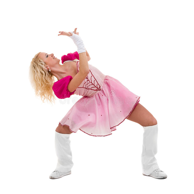 Disco dancer showing some movements against isolated white. Disco dancer woman showing some movements against isolated white background stock photo