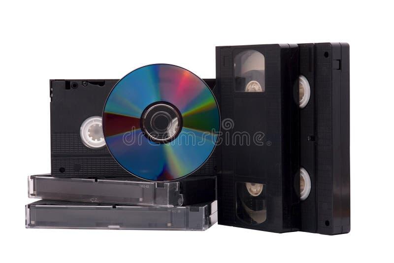 Disco de DVD e fitas do VHS foto de stock