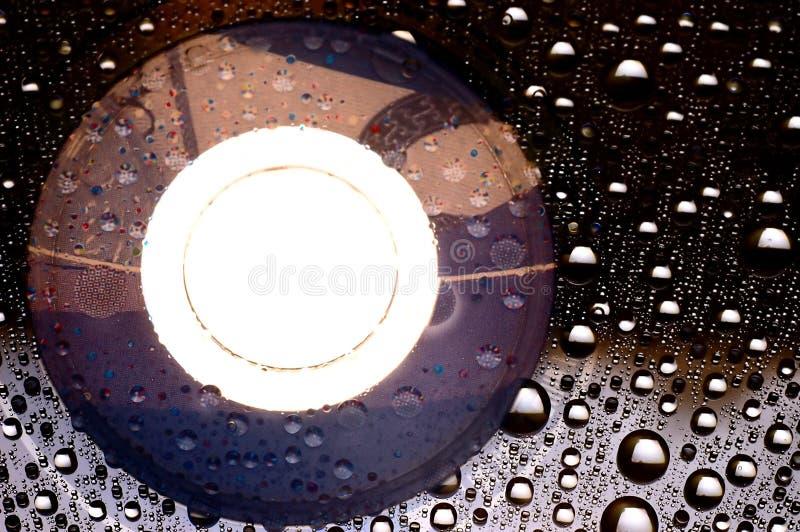 Disco di DVD con le goccioline fotografia stock