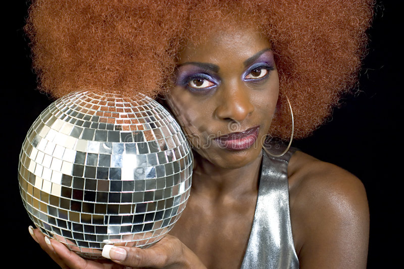 Disco Diva 3. Attractive black woman wearing purple makeup and holding a disco ball royalty free stock photos