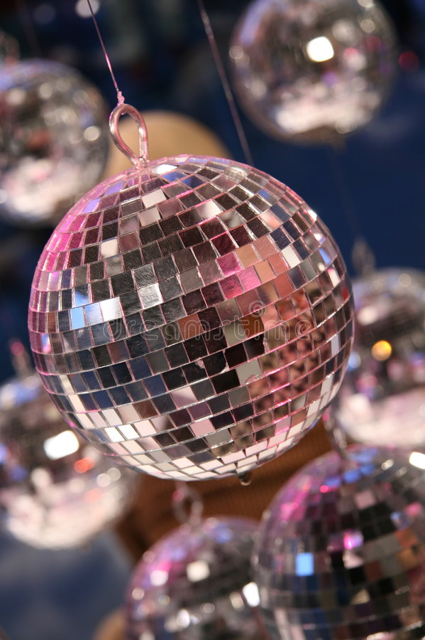 Disco fever. Retro disco fever with lots of glitter balls stock image