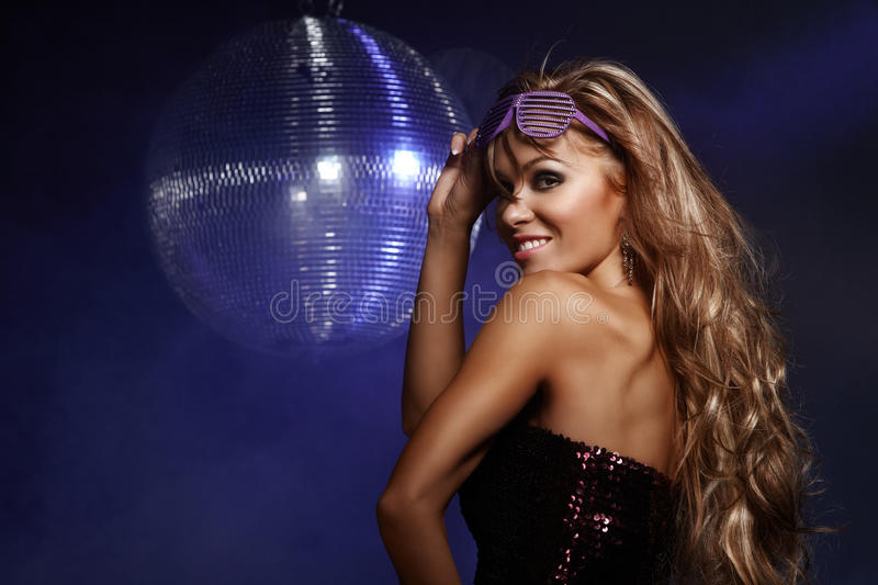 Disco girl. Portrait of dancing girl on disco party royalty free stock photo