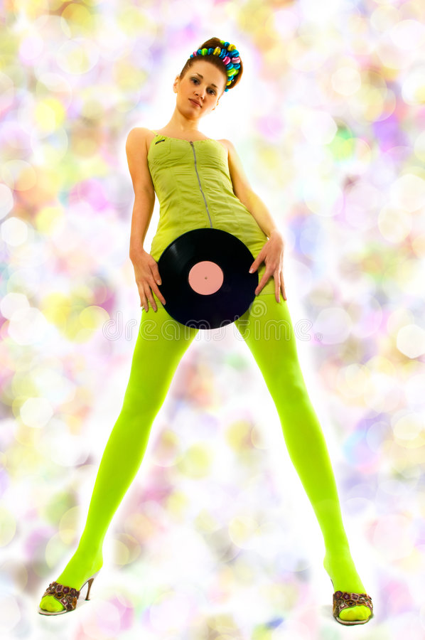 Disco girl with vinyl. / on green stock images