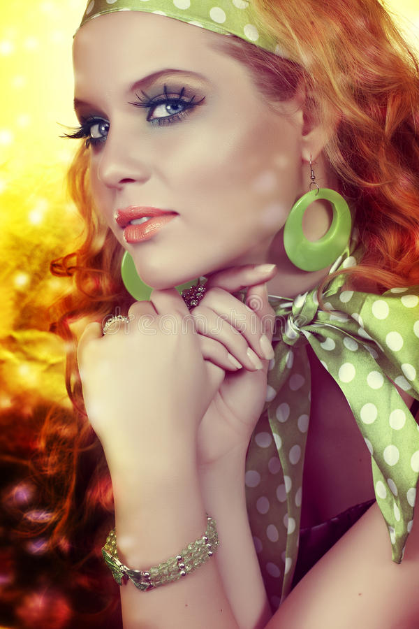 Disco lights retro beauty. Beautiful woman with long hair and green polka dot scarf with disco lights from 16 Bit RAW stock photo
