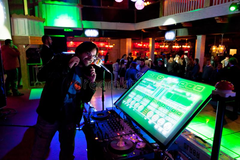 Disco Party of Los 40 Principales. CHICLANA, SPAIN - JAN 27: DJ Alvaro Reina next to the mixer to begin the party of the hot mix energy danceflor of the Los 40 stock images