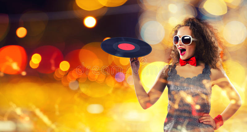 Disco party. Young pretty girl dj at disco party holding vinyl stock images