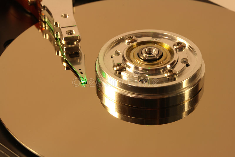 Disco rígido sob o laser verde foto de stock royalty free