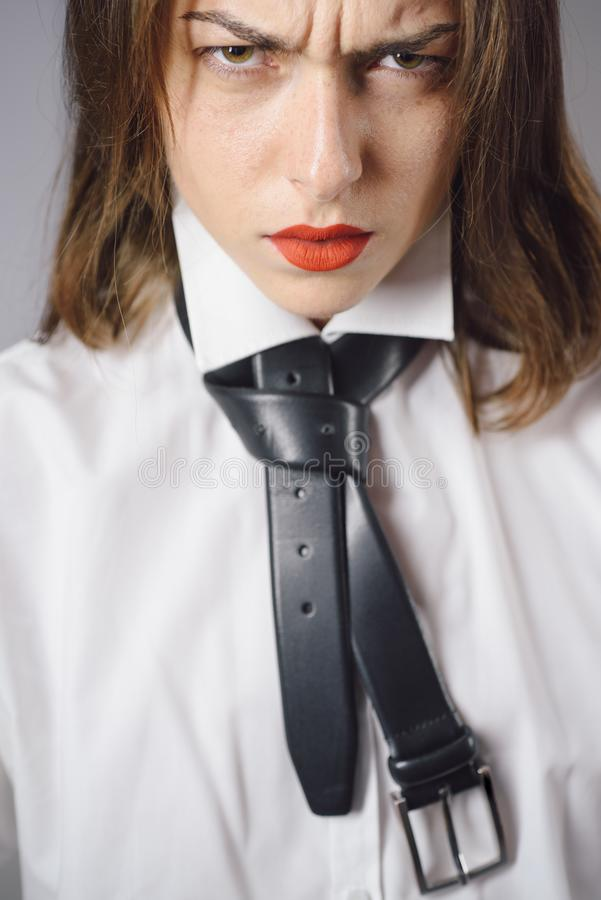 Discontent. Sexy young woman with red lips. Feminism. Close up. stock images