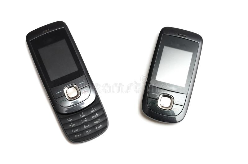 A discontinued 2G slide mobile phone in closed and opened call positions stock photography