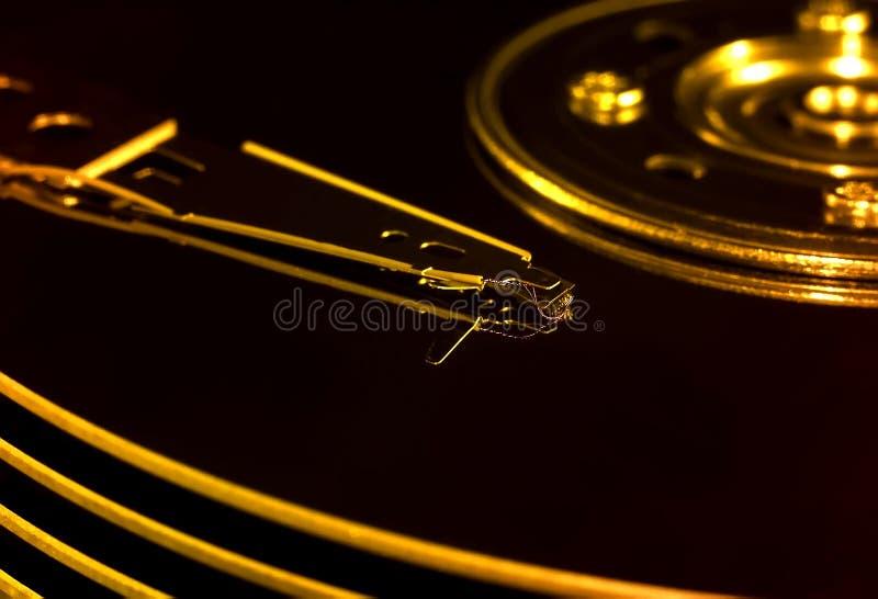 Discos del disco duro con la cabeza imagen de archivo libre de regalías