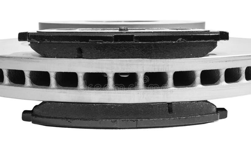 Discos del freno y zapatas de freno aisladas en el fondo blanco Piezas de autom?vil Rotor del disco del freno aislado en blanco P fotografía de archivo