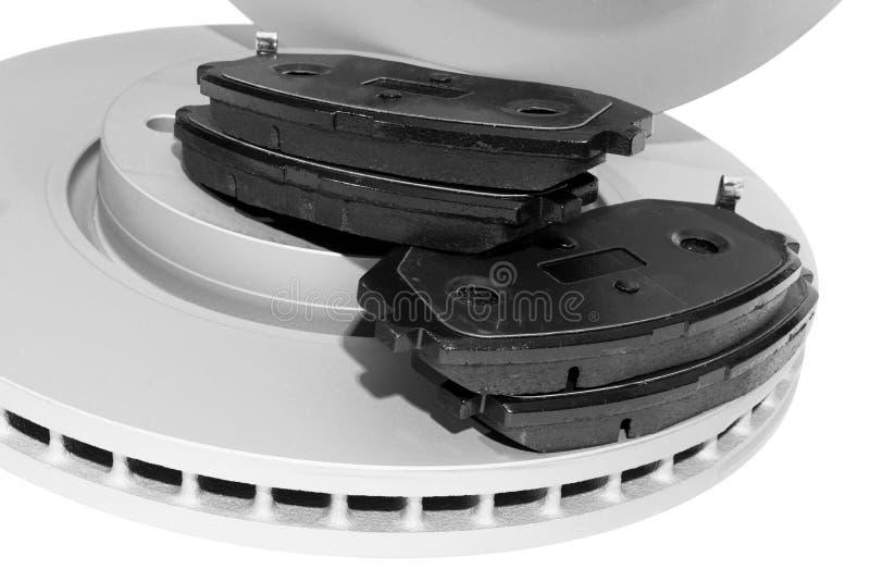 Discos del freno y zapatas de freno aisladas en el fondo blanco Piezas de autom?vil Rotor del disco del freno aislado en blanco D imágenes de archivo libres de regalías