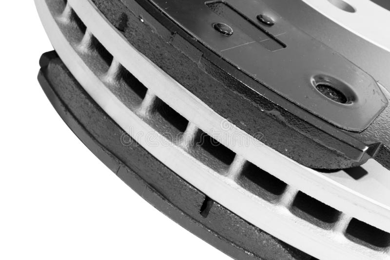 Discos e pastilhas dos freios do freio isolados no fundo branco Pe?as de autom?vel Rotor do disco do freio isolado no branco Disc foto de stock royalty free